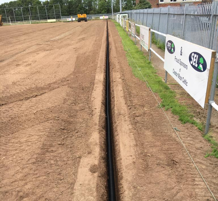 Laying drainage channels